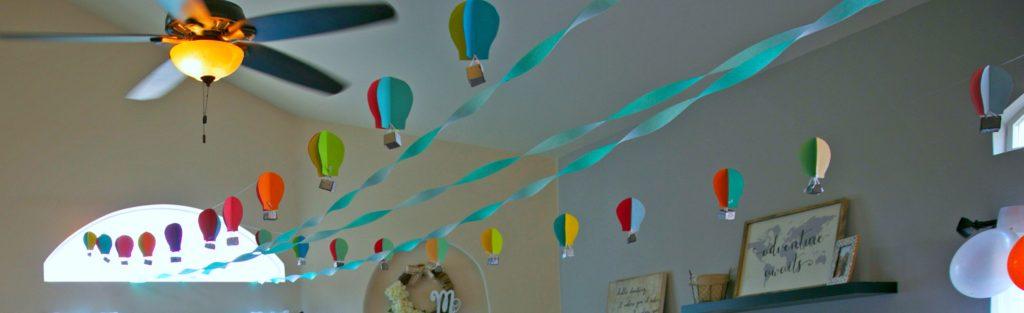 dr seuss birthday party colorful truffula trees colored popcorn balloon cake smash cake