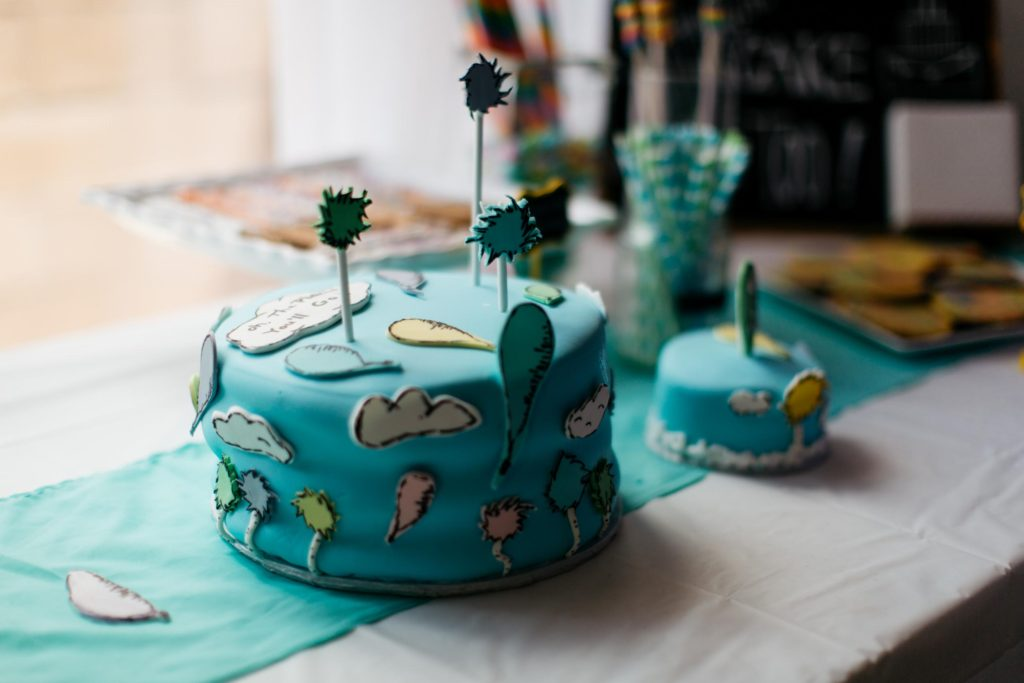 dr seuss birthday party colorful truffle trees colored popcorn balloon cake smash cake