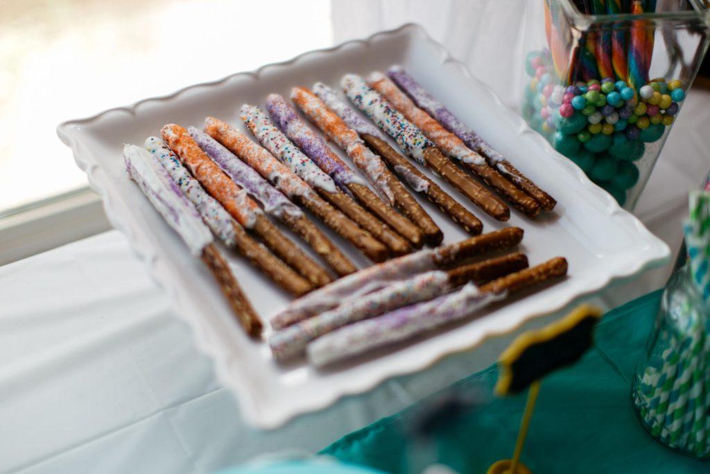 dr seuss birthday party colorful truffle trees colored popcorn balloon cake smash cake chocolate pretzels sexless