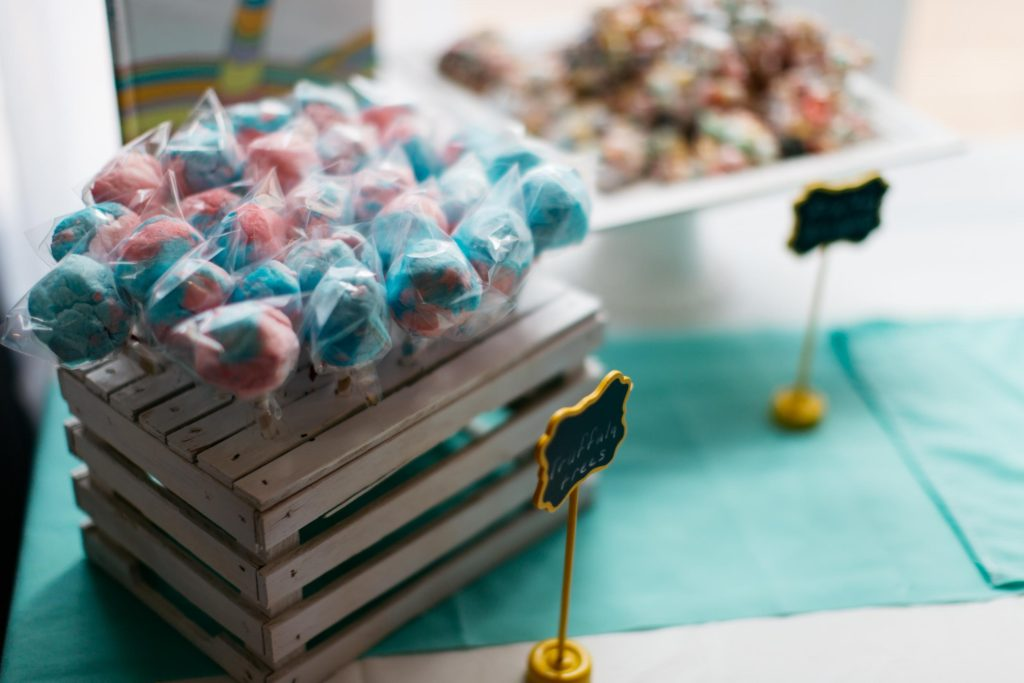 dr seuss birthday party colorful truffula trees cotton candy colored popcorn balloon cake smash cake