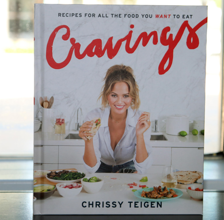 Chrissy Teigen shows off her baby bump at Books and Books in Miami for Cravings Book signing. Teigen was accompanied by her husband John Legend. Note Photos Feb 26, 2016 Pictured: Chrissy Teigen Cravings Book cover Ref: SPL1236409 260216 Picture by: Charlie Ans / Splash News Splash News and Pictures Los Angeles:310-821-2666 New York: 212-619-2666 London: 870-934-2666 photodesk@splashnews.com