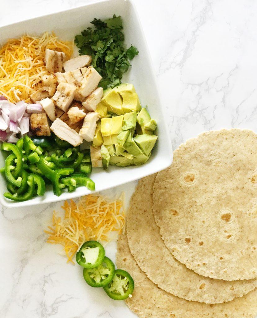 healthy chicken avocado burrito with jalapeño and cilantro