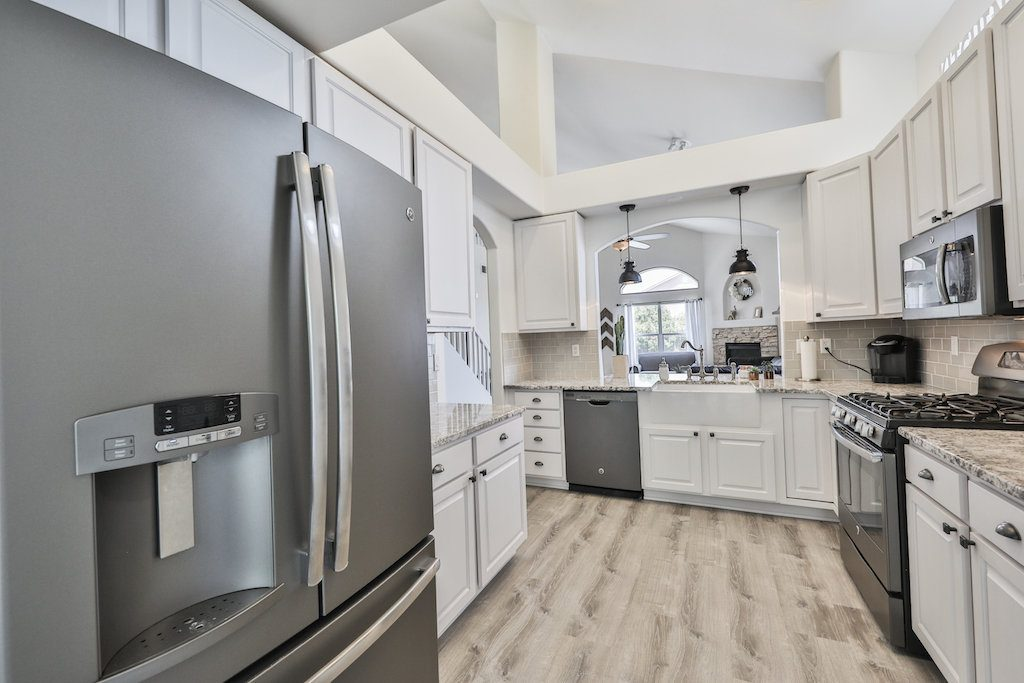 kitchen renovation before and after white cabinets farmhouse sink pendant lights granite white kitchen home decor house tour home design house design nursery new build home build target rugs wood floor vinyl floors