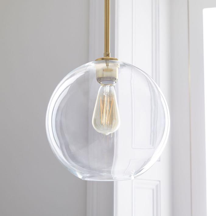 kitchen island lighting, kitchen island pendants, brass pendants, globe pendant, brass globe pendant, modern kitchen lighting