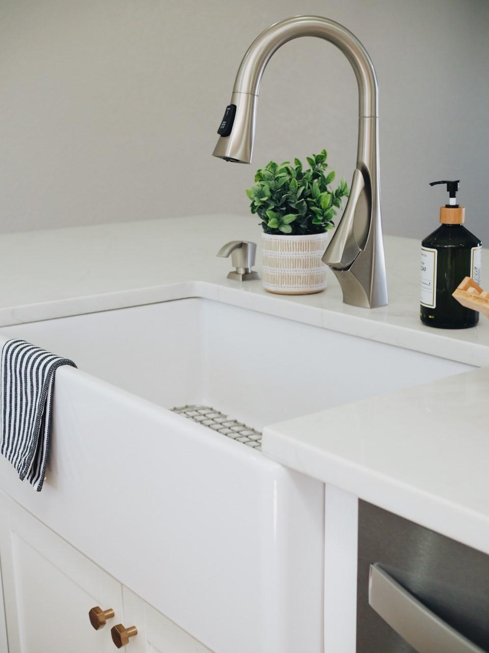 white kitchen home renovation kitchen renovation farmhouse sink single basin sink brass hardware white cabinets double island kitchen