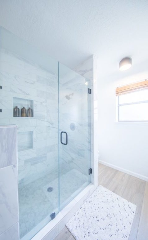 modern bathroom, modern master bathroom, bathroom renovation, fixer upper, black vanity, black mirrors, marble shower, small bathroom renovation
